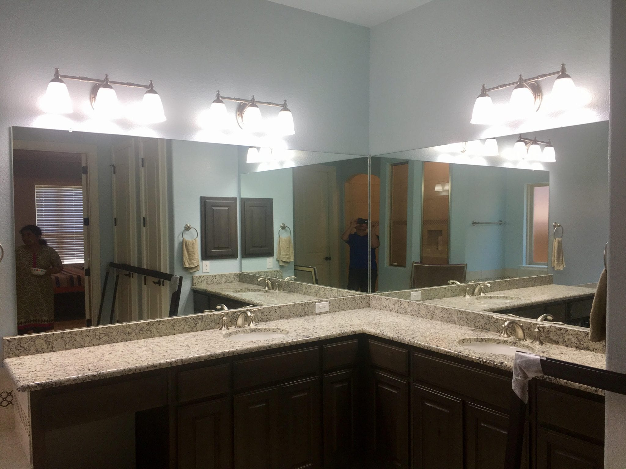 bathroom mirror and frame hanging